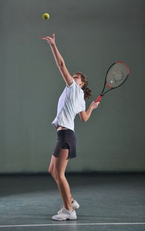 tennis skirt: one woman playing tennis sport indoor