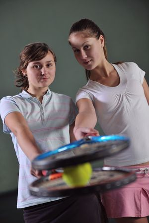 two girls recreating tennis sport photo