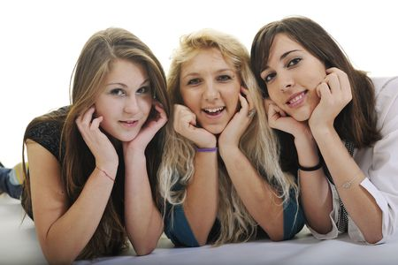 smilling: happy three young girls teen playing and smilling isolated on white in sutdio Stock Photo