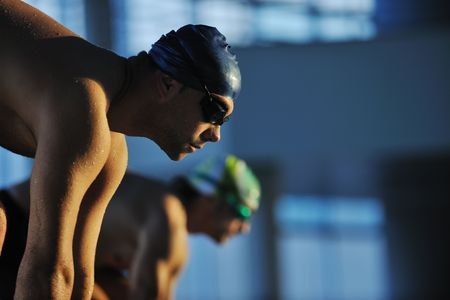 start position: start position race concept with fit swimmer on swimming pool Stock Photo