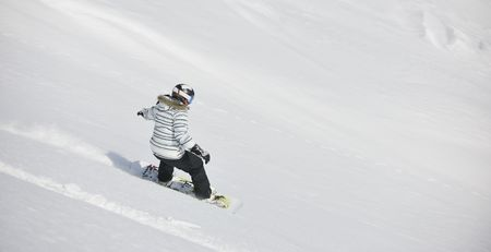 snowboard woman racing downhill slope and freeride on powder snow at winter season and sunny day Stock Photo - 6349295