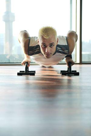 young healthy man exercise fitness indoor in sport studio photo
