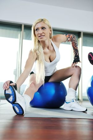 woman exercise fitness and get nice fit shape in fitness sport club indoor photo
