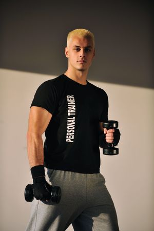 athletic wear: man fitness personal trainer in sport club
