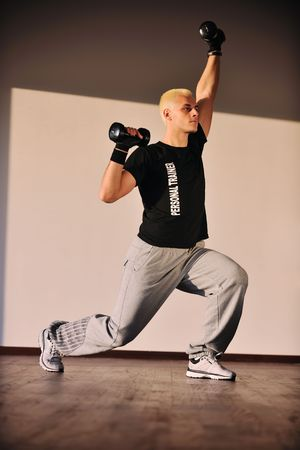 man fitness personal trainer in sport club Stock Photo - 6403373