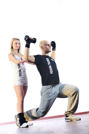 athletics training: fitness personal trainer in fitness club exercise with client Stock Photo