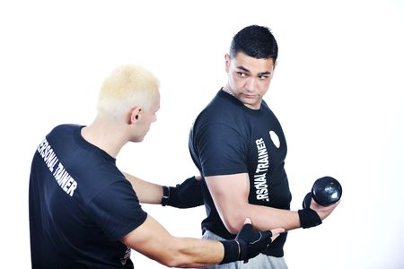 man fitness personal trainer in sport club photo
