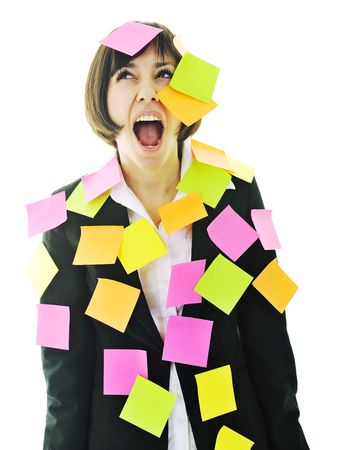 worried woman: one frustrated young business woman with many of post it representing concept memory and frustration on work Stock Photo
