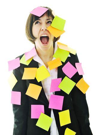 ansiedad: una mujer de negocios de j�venes frustrados con muchos de post it que representa el memoria de concepto y la frustraci�n en el trabajo  Foto de archivo