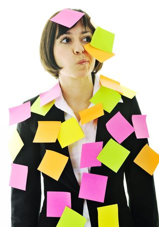one frustrated young business woman with many of post it representing concept memory and frustration on work Stock Photo - 6515475