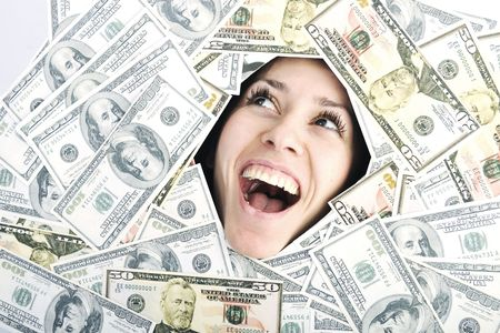 happy young business woman isolated on white playing with dollars money and representing success in finance photo