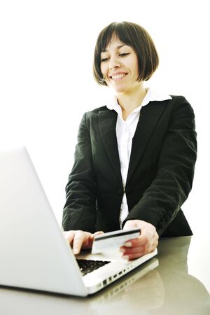 young business woman making online payment with credit card and representing concept of new age in banking and plastic money photo