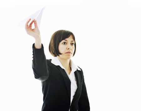 happy young business woman isolated ona white throwing paper airplane Stock Photo - 6515752