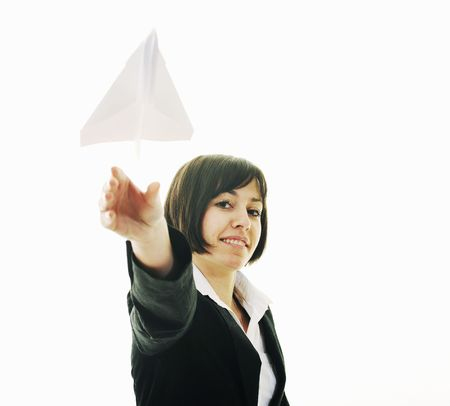 happy young business woman isolated ona white throwing paper airplane Stock Photo - 6515831