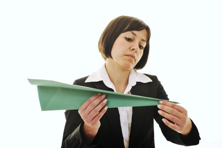 happy young business woman isolated ona white throwing paper airplane  Stock Photo - 6515770