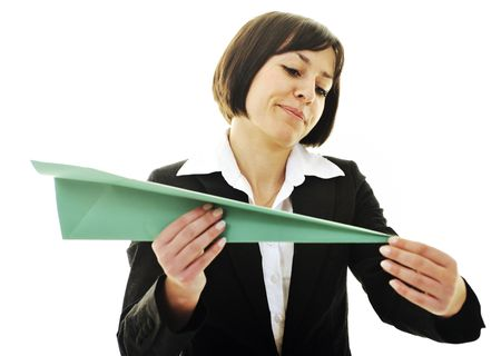 happy young business woman isolated ona white throwing paper airplane  Stock Photo - 6515985