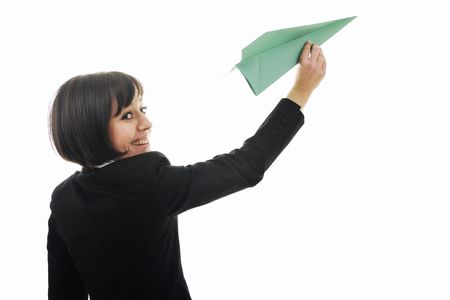 happy young business woman isolated ona white throwing paper airplane  photo