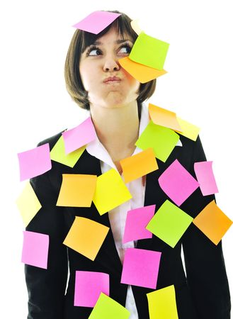 post it notes: one frustrated young business woman with many of post it representing concept memory and frustration on work Stock Photo