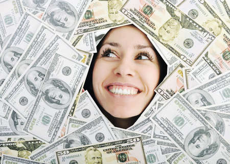 playing with money: happy young business woman isolated on white playing with dollars money and representing success in finance Stock Photo