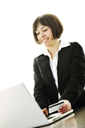 young business woman making online payment with credit card and representing concept of new age in banking and plastic money Stock Photo - 6538811