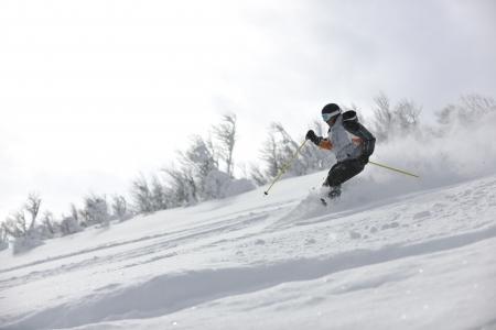 downhill: man ski free ride downhill at winter season on beautiful sunny day and powder snow