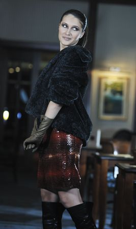 beautiful young woman lady in fashion dress posing in restaurant or bar at night photo