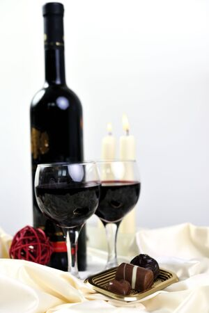 luxury and sweet praline and chocolate with wine bottle and glasses  decoration photo