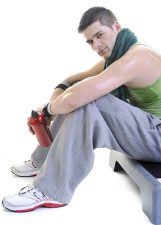 young adult man relax and drink water with sweat on body photo