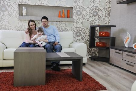 happy youg family relaxing in modern livingroom at home Stock Photo - 13327164