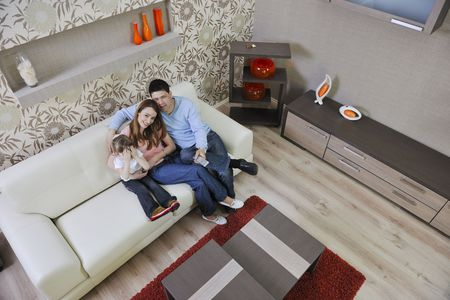 happy youg family relaxing in modern livingroom at home Stock Photo - 13327165