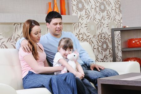happy youg family relaxing in modern livingroom at home Stock Photo - 13327156
