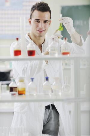 young man scientist in chemistry bright lab Stock Photo - 6846322