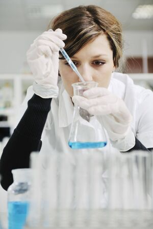 science chemistry classes with young student woman in labaratory photo