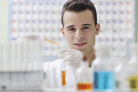 young man scientist in chemistry bright lab Stock Photo - 6846458