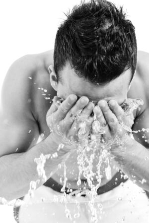 young man washing face with clean water and representing hygiene and mans beauty concept Stock Photo - 6878782