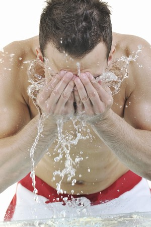 white wash: young man washing face with clean water and representing hygiene and mans beauty concept