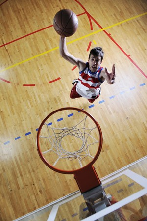 young healthy man play basketball game indoor in gym photo