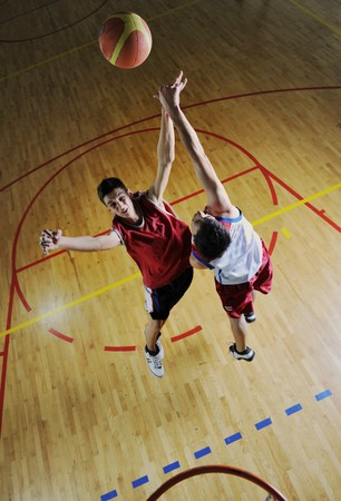 competition cencept with people who playing and exercise  basketball sport  in school gym photo