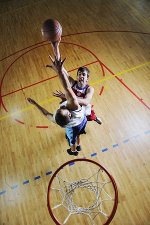 competition cencept with people who playing and exercise  basketball sport  in school gym Stock Photo - 7612278