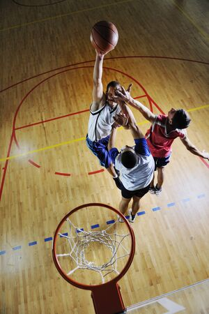 competition cencept with people who playing and exercise  basketball sport  in school gym Stock Photo - 8108078