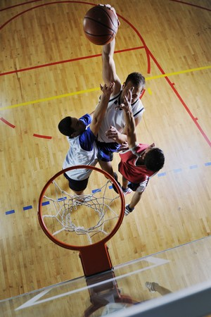 games hand: competition cencept with people who playing and exercise  basketball sport  in school gym