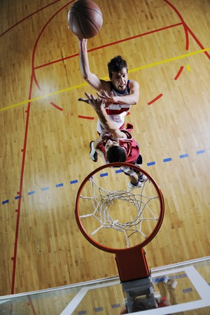 competition cencept with people who playing and exercise  basketball sport  in school gym Stock Photo - 7611965