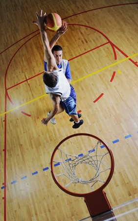 duel: competition cencept with people who playing and exercise  basketball sport  in school gym