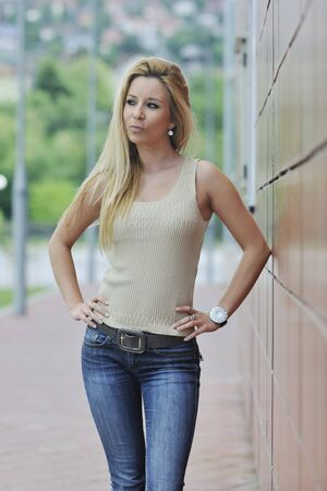 woman outdoor in casual fashion clothes representing urban style concept and fashion photo