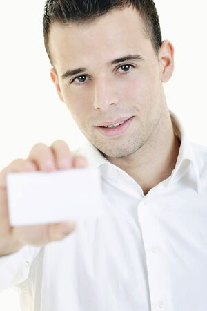 happy young business man with empty card isolated on white photo