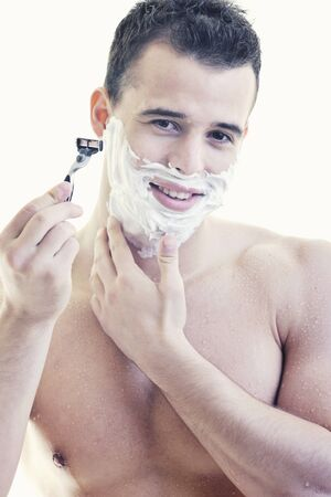 shaving cream: young handsome man have shaving isolated on white