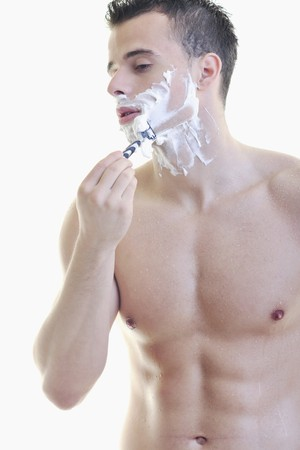 male grooming: young handsome man have shaving isolated on white
