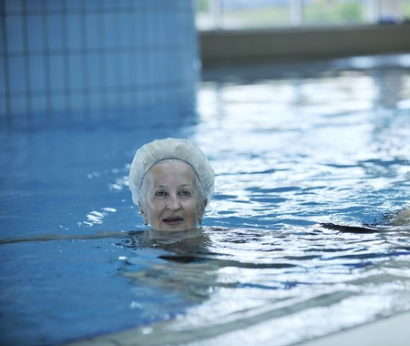 beautiful old senior  woman have fun and recreation on swimming pool Stock Photo - 7029254