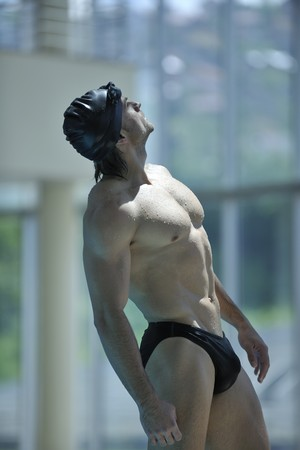 young healthy with muscular body man swim on swimming pool and representing healthy and recreation concept photo