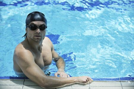 young healthy with muscular body man swim on swimming pool and representing healthy and recreation concept Stock Photo - 7029391